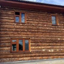 Финские окна в деревянном бревенчатом доме